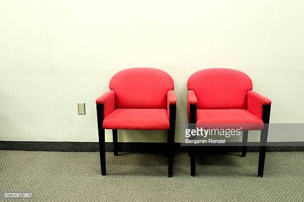 Two Red Office Chairs