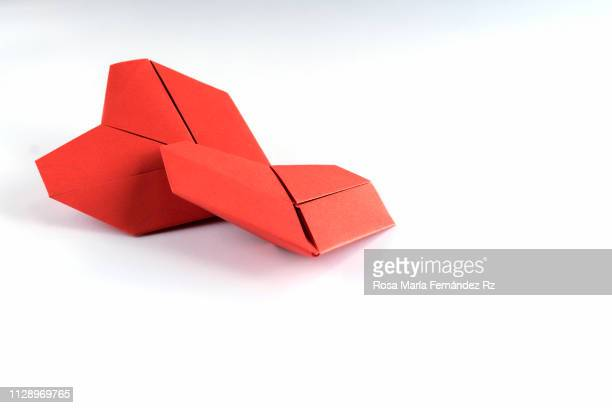 two red origami heart shape on white backgroud. selective focus and copy space. - heart month stock photos and pictures