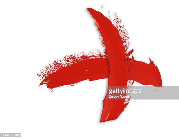 two red paint strokes in the shape of a cross on a white background. - x marks the spot stock pictures, royalty-free photos & images
