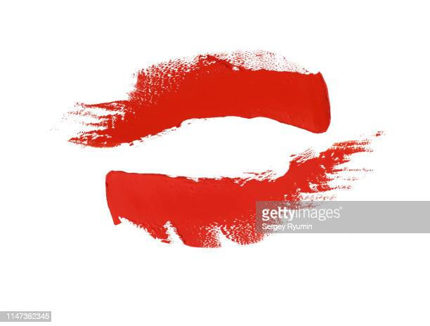 two red paint strokes on a white background. - aaien stockfoto's en -beelden