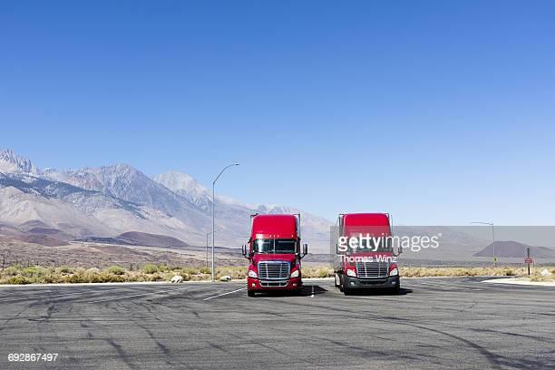 Two Red Semi Trucks
