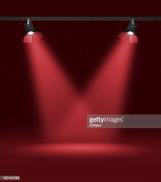 Two red spotlights shedding light on a black background