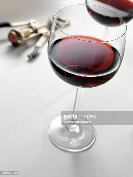 two red wine glasses with cork screw - pinot noir grape stock photos and pictures