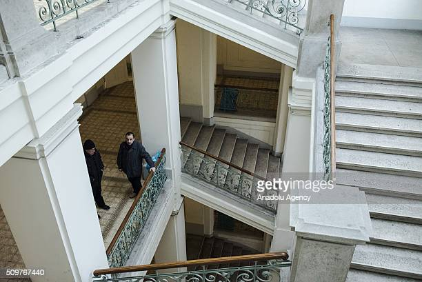 Two refugees stand on the second floor of the Red Cross shelter in Vienna, Austria on February 11, 2016. The refugee shelter is located right in the...