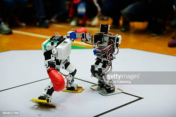 Two remotely-controlled humanoid robots fight in a national contest on May 28, 2016 in Rizhao, China. Over 6,000 students and teachers from 220...