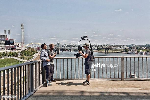 Two reporters are walking and talking