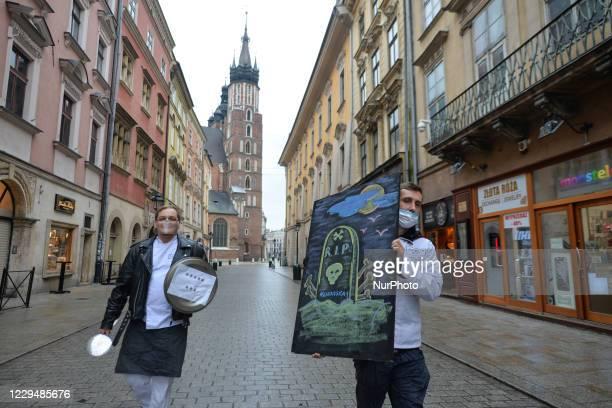 Two representatives of Krakow gastronomy, return in empty Florianska Street, from a protest organised in Krakow's Market Square, on November 3, 2020....