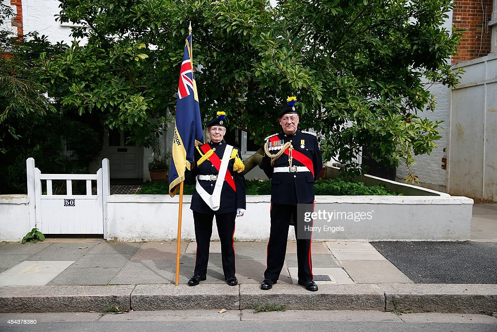 Two representatives of the Royal British Legion pose for a photograph ahead of the Sky Bet Championship match between Fulham and Cardiff City at Craven Cottage on August 30, 2014 in London, England.