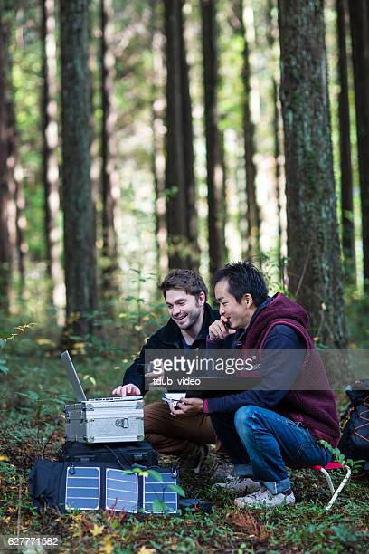 Two researchers working at a solar powered field station