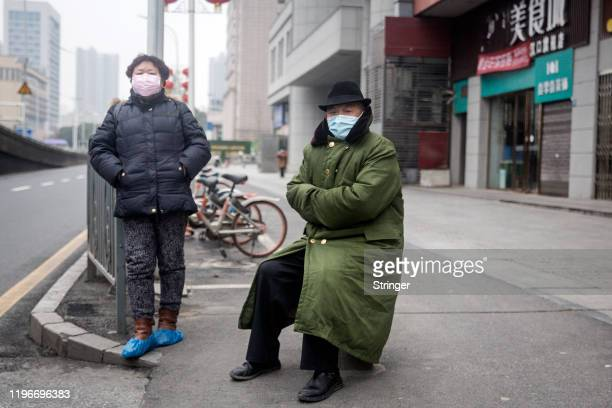 Two residents wear protective masks on January 27 2020 in Wuhan China As the death toll from the coronavirus reaches 80 in China with over 2700...