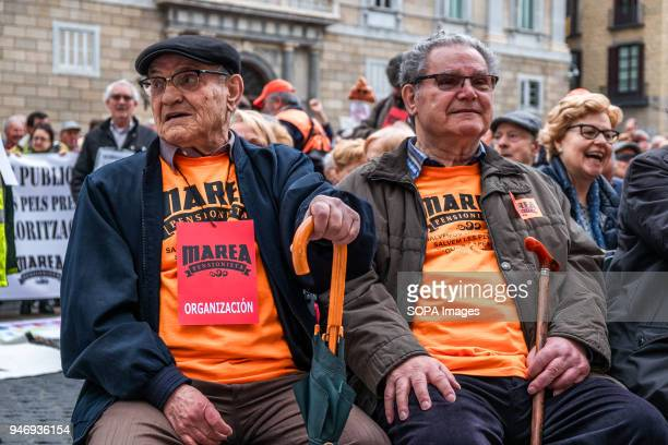 Two retired men wait seated the beginning of the reading of the communiqués Hundreds of retirees and pensioners have demonstrated in the streets of...