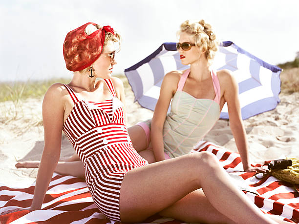 Two retro young women on beach