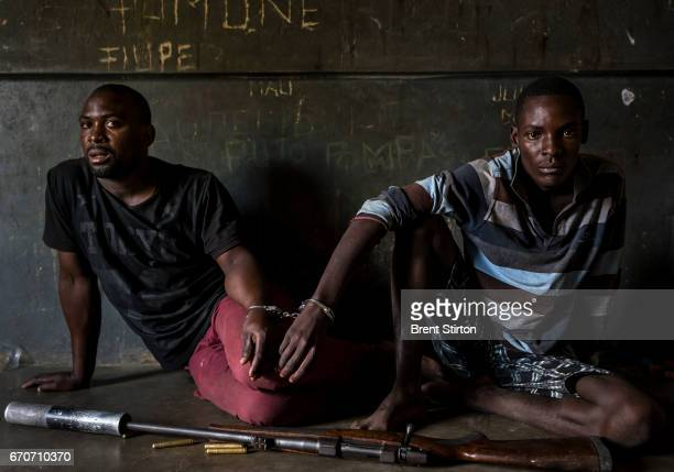Two rhino poachers one 19 the other 28 years old apprehended by an antipoaching team in Mozambique close to Kruger National Park border They are seen...