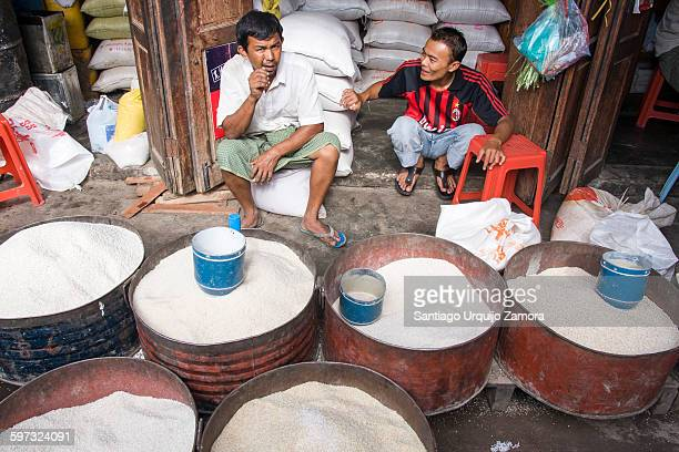 Two rice sellers discussing at a market, Nyaungshwe Township, Taunggyi District, Inle Lake, Shan State, Myanmar