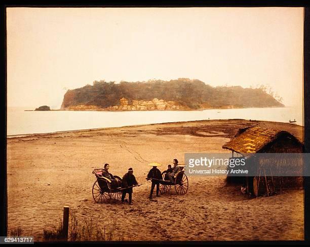 Two Rickshaws on Beach With View of Enoshima Japan circa 1880