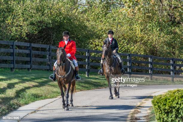 Two riders after the Annual Blessing of the Hounds at the Iroquois Hunt Club in Kentucky