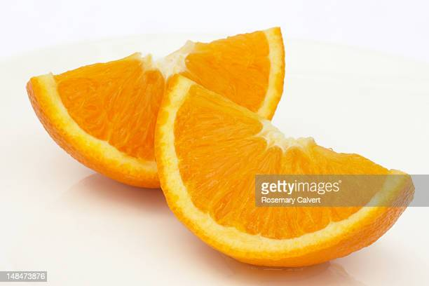 two ripe, juicy jaffa orange quarters - slice stock pictures, royalty-free photos & images