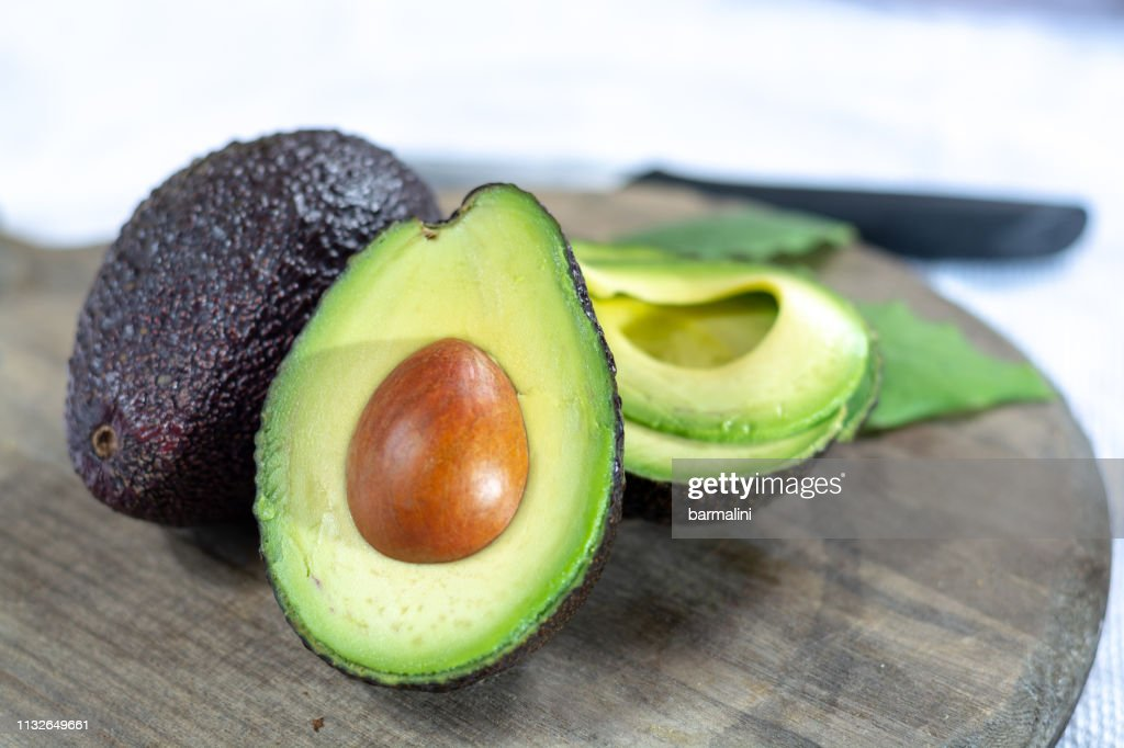 Two ripe raw hass avocados close up : Stock Photo