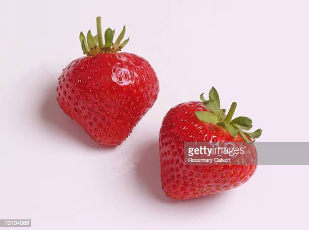 Two ripe strawberries, close-up