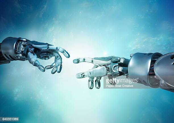 two robot hands reaching out for each other