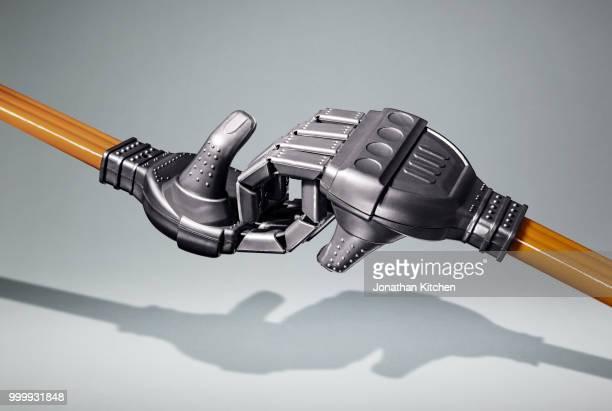 two robotic type hands