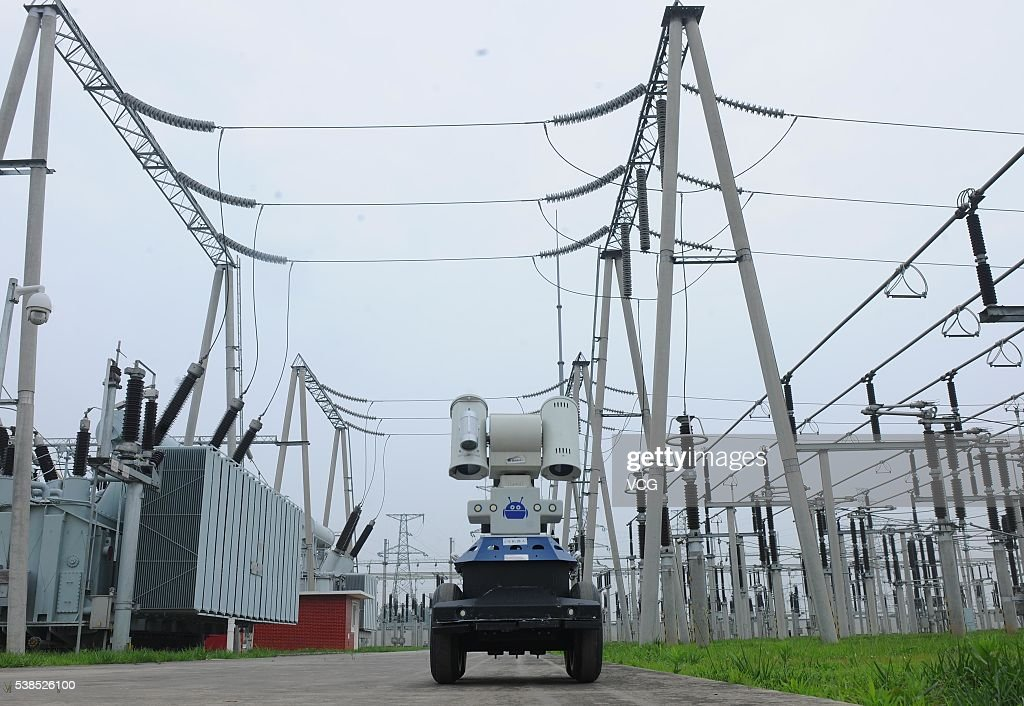 Two robots inspect the equipment in a 220kV electrical