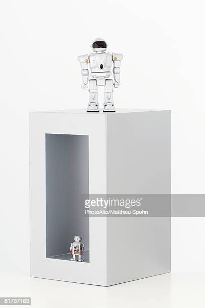 Two robots, one inside box, the other on top of box