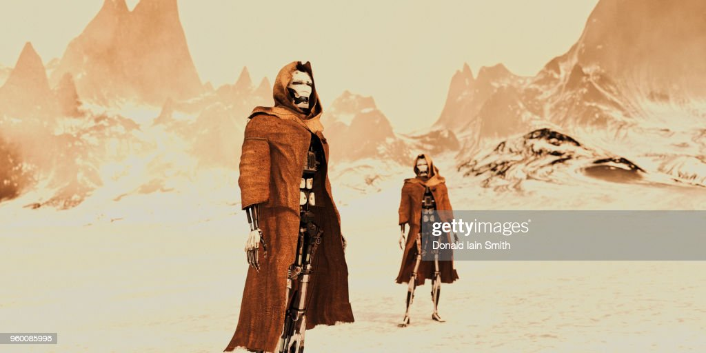 Two robots wearing ragged torn robes stand in mountainous bleak landscape : Stock-Foto
