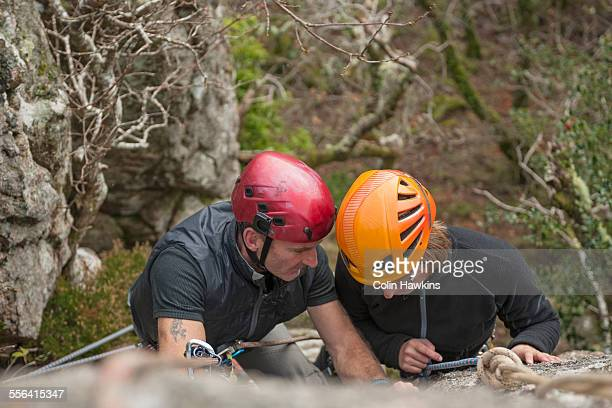two rock climbers, high angle - colin hawkins stock pictures, royalty-free photos & images