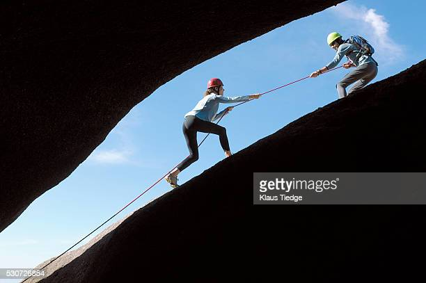 Two rock climbers next to a crevasse