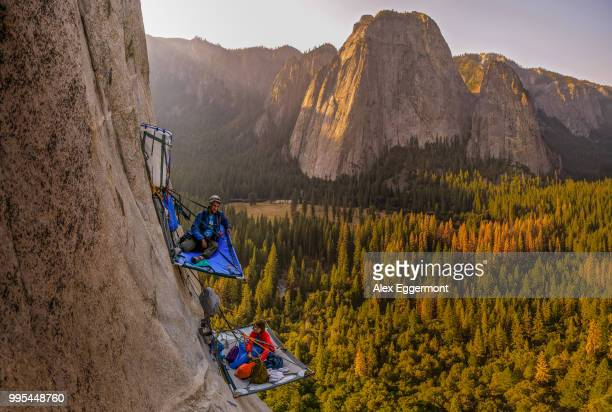 two rock climbers on portaledges on triple direct, el capitan, yosemite valley, california, usa - el capitan yosemite national park stock pictures, royalty-free photos & images