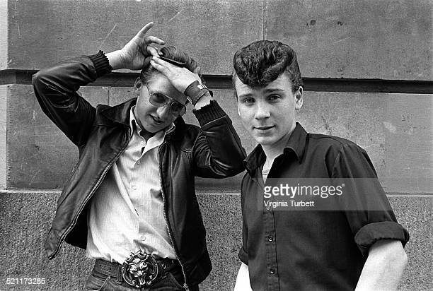 Two rockabilly fans wearing retro Teddy Boy fashions and with prominent quiff hairstyles London 1980s