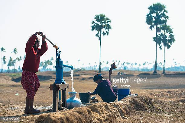 Two Rohingya girls undertake daily tasks in Coconut Garden an unregistered camp on the outskirts of Sittwe where many Rohingya arrived after fleeing...
