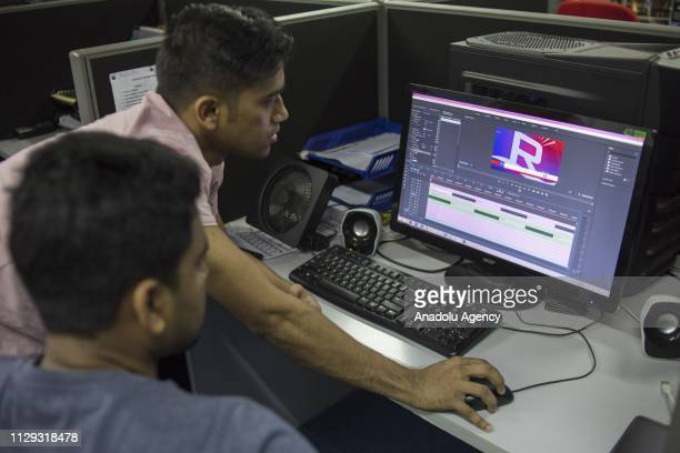 Two Rohingya refugees Naeem and Zaker Ahmad edit the video after the recording session at Rohingya Vision TV studio in Kuala Lumpur Malaysia on March...