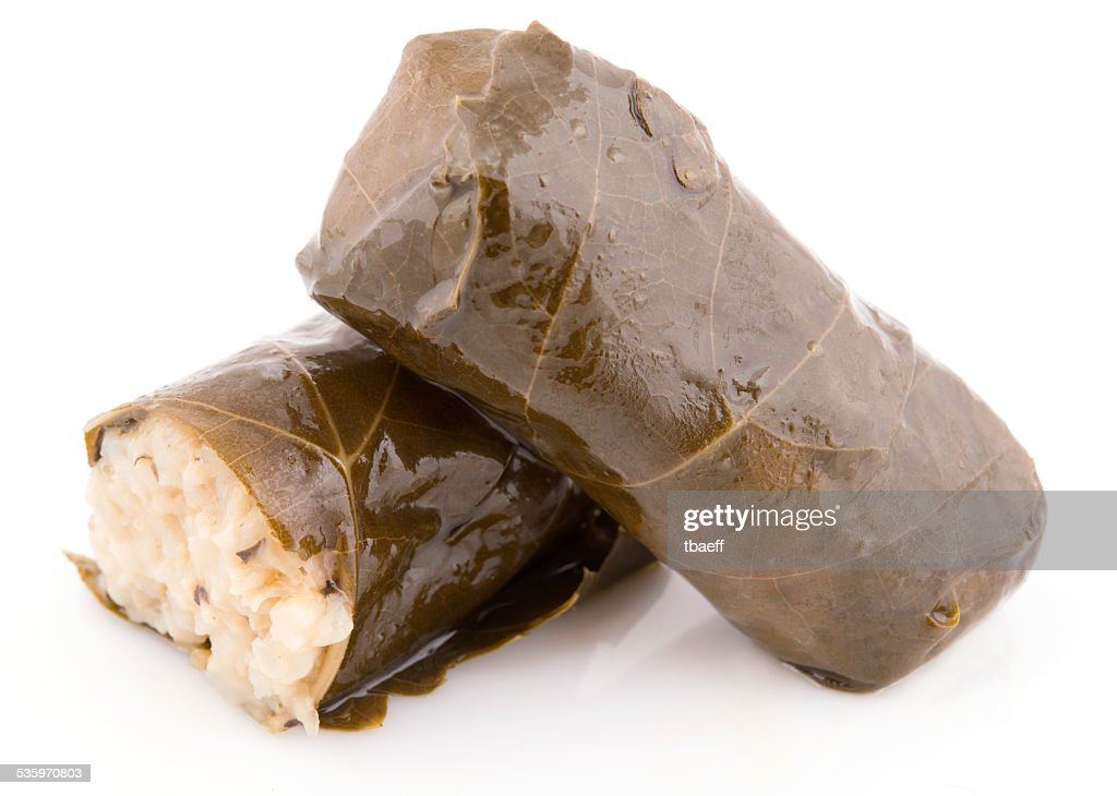 two rolls vine leaves stuffed with rice isolated : Stock Photo