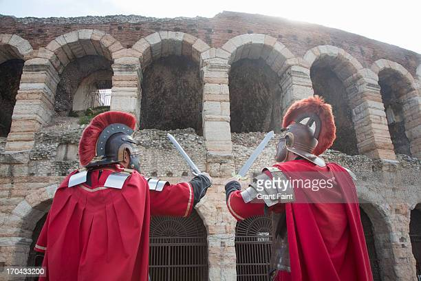 two  romans at coliseum - ancient rome stock pictures, royalty-free photos & images