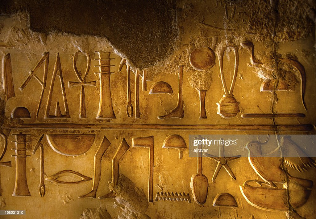 Two rows of Egyptian Hieroglyphics : Stock Photo