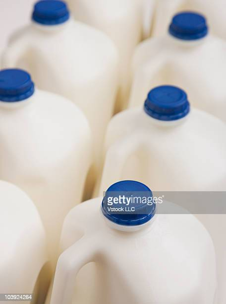 Two rows of milk in plastic containers