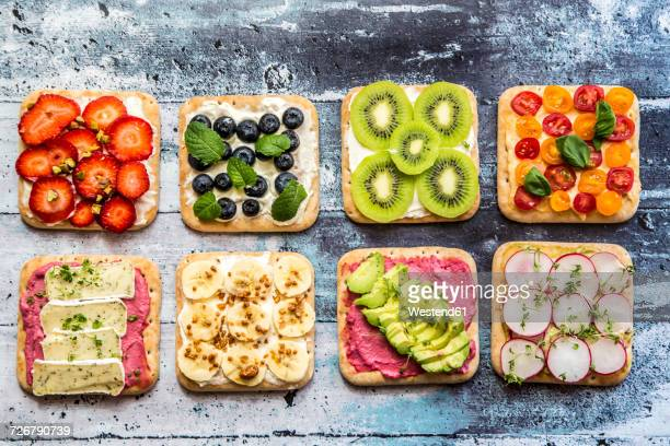 two rows of various garnished sandwiches - nut food stock photos and pictures