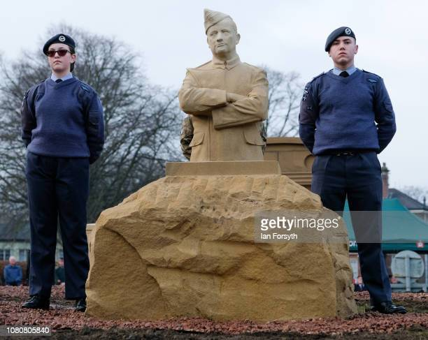 Two Royal Air Force cadets stands next to a sculpture of a member of the Royal Flying Corps during an unveiling by former Royal Engineer and Dunkirk...