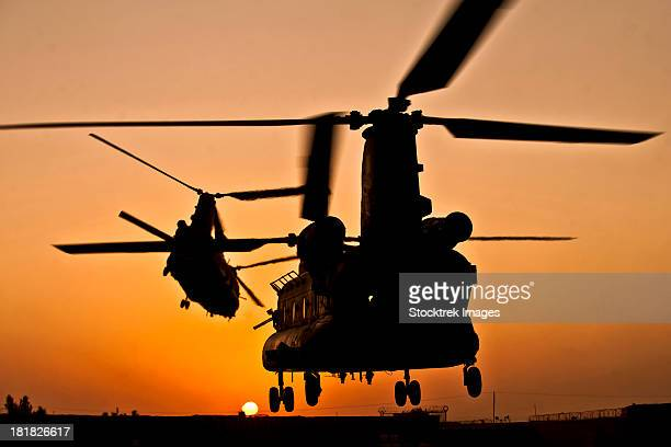 Two Royal Air Force CH-47 Chinooks take off from Task Force Helmand headquarters in Lashkar Gah district, Helmand province, Afghanistan.