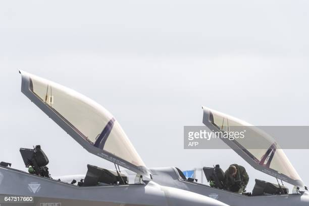 Two Royal Australian Air Force F35 aircraft sit on the tarmac during the Australian International Airshow at Avalon airport on March 3 2017 The...