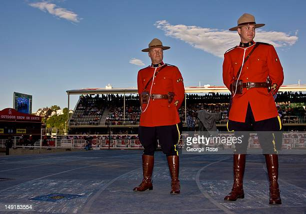 Two Royal Canadian Mounted Police take part in the opening ceremonies on July 6 2012 in Calgary Canada Calgary Stampede the world's largest outdoor...