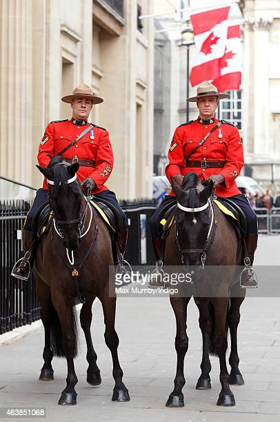 Two Royal Canadian Mounted Policemen on horseback await the arrival of Queen Elizabeth II to officially reopen Canada House on February 19 2015 in...
