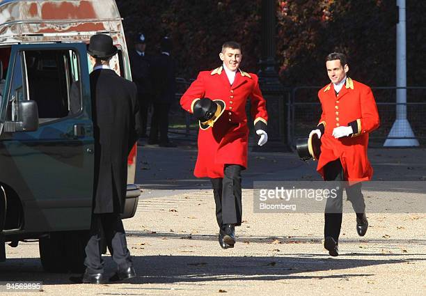 Two royal footmen run towards their transport after attending the state visit of King Abdullah of Saudi Arabia on Horseguards Parade in central...