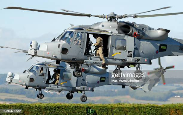 Two Royal Navy Wildcat Maritime Attack Helicopters depart The Royal Marines Commando Training Centre after transporting Prince Harry Duke of Sussex...