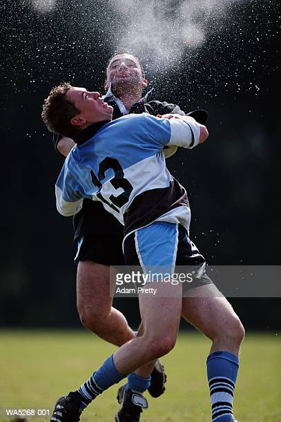 Two rugby players in action