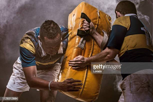 two rugby players training - tackling stock pictures, royalty-free photos & images