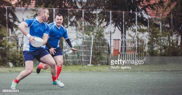 Two rugby players training