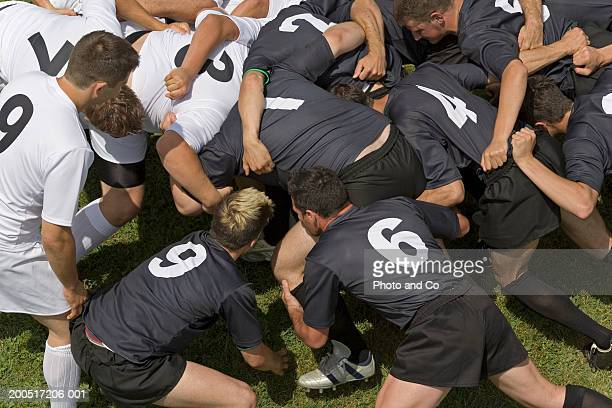 two rugby teams in scrum on pitch, elevated view - scrum stock pictures, royalty-free photos & images